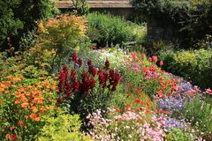 Cottage garden. Cottage garden with many blooming flowers on a Sunny day in Great Dixter House & Gardens in England in the beautiful summer stock image