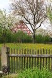 Cottage garden and old farmhouse Stock Photo