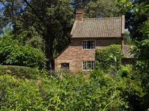 Cottage garden of small brick home Royalty Free Stock Image