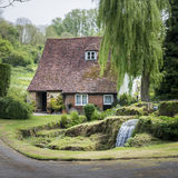 Cottage, Garden and stream. Old cottage with waterfall in the garden, in the pretty village of Loose, Kent, UK Stock Photography