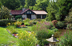 Cottage with Gardens. Small estate with quiet cottage and large garden areas Royalty Free Stock Photography