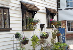 Cottage hanging baskets flowers Royalty Free Stock Image