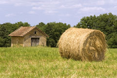Cottage and haystack. Small cottage in a French field next to a large haystack royalty free stock image