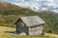 Cottage in alps Stock Images