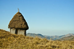 Cottage on a hill. Cottage made out of natural elements on top of a hill from Transilvania Stock Photos