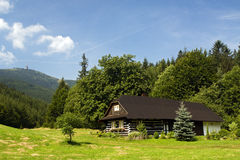 Cottage in hills stock photography