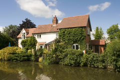 Cottage house alongside canal Royalty Free Stock Photo