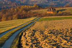 Cottage house in autumn fields Stock Photo