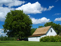 Cottage house and blue sky. Cottage house and blue cloudy sky, wallpaper royalty free stock photo