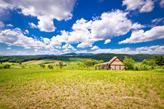 Cottage in idyllic agricultural landscape Stock Photo