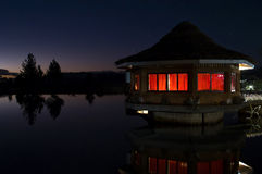 Cottage illuminated at night Royalty Free Stock Photography