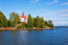 Cottage on island in Scandinavia Stock Image