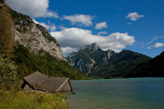 Cottage in the lake. Rocky mountains wiht decrepit cottage and lake Royalty Free Stock Photo