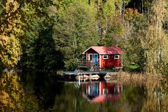 Cottage by the lake. Typical Swedish cottage by lake Ovre Vekmangeln, Ostergotland, Sweden Royalty Free Stock Image
