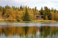 Cottage by lake Stock Photography