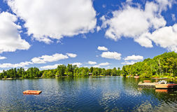Cottage lake with diving platform and dock. Beautiful lake with dock and diving platform in Ontario Canada cottage country Stock Image