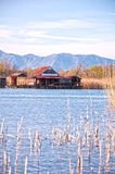 Cottage Lake-Lake dwellings. Mountains on the background Royalty Free Stock Photo