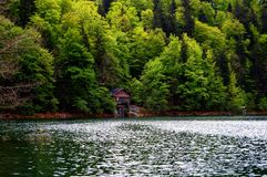 Cottage by the lake in the mountains stock photography