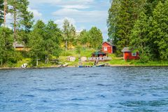 Cottage by the lake in rural Finland Royalty Free Stock Photos