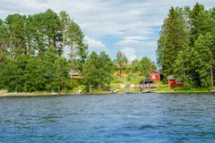 Cottage by the lake in rural Finland Stock Photography