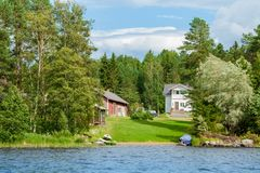 Cottage by the lake in rural Finland Stock Photo