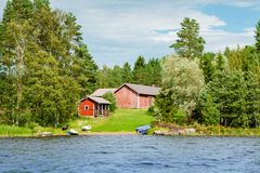 Cottage by the lake in rural Finland Stock Image