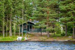 Cottage by the lake in rural Finland Stock Photos