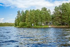 Cottage by the lake in rural Finland Royalty Free Stock Images