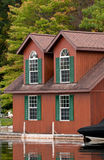 Cottage with large windows Royalty Free Stock Photos