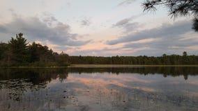 Enjoying the Sunset. Enjoying the lake at the cottage and the beautiful sunset Royalty Free Stock Photography