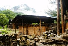 Cottage of the Lisu nationality. Yunnan Nationalities Cottage usually be built in tourism scenic spots with beautiful environment and long cultural history. Most Stock Photos