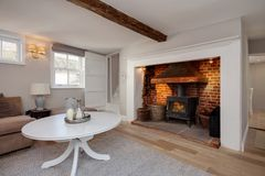 Cottage living room with fireplace and stove Stock Photos
