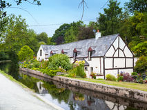 Cottage on Llangollen Canal Wales UK. Cottage called Pen-y-Ddol on the Llangollen Canal in Denbighshire Wales UK Royalty Free Stock Photos