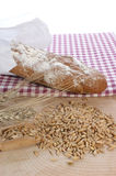 Cottage loaf and cereal on a timber background royalty free stock images