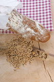 Cottage loaf and cereal on timber background stock photos