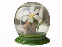 Cottage magico e un fiore in un globo della neve Immagine Stock