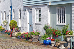 Cottage mews and potted plants Stock Images