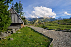 Cottage in mountain grassland Royalty Free Stock Photos