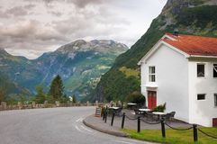 Cottage, mountains and clouds in Geiranger. Norway royalty free stock image
