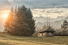 Cottage in the mountains. And sunsets Stock Photo