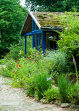 Cottage in natural garden. In summer Royalty Free Stock Photos