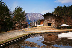Cottage near the pond at Gassho-zukuri Village/Shirakawago Stock Photography