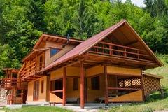 Cottage nel più forrest Fotografia Stock