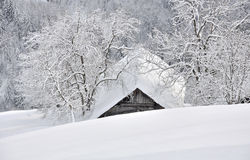 Cottage nestled in the snowy mountain Stock Image