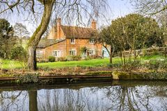 Cottage next to water Royalty Free Stock Images