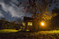 Cottage at night. In a colorful and mystical landscape stock images