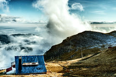 Cottage on a peak with view at beautiful clouds Royalty Free Stock Photos