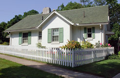 Cottage with Picket Fence. Small, quiet cottage with white picket fence Royalty Free Stock Images