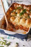 Cottage pie in the baking dish closeup. vertical Stock Images