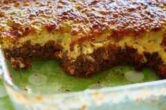 Cottage pie in a casserole. Glass casserole with cottage pie, British recipe Royalty Free Stock Images